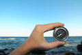 Orientation concept a male hand holding a metal compass Stock Photography