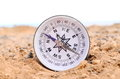 Orientation concept metal compass on a rock in the desert Royalty Free Stock Image