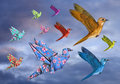 Origami bird dreamscape and stylized birds flying across the sky Royalty Free Stock Image