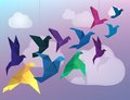 Origami birds flying and fake clouds background Stock Photo