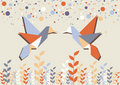 Origami hummingbird couple over beige Royalty Free Stock Photo