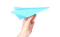 Origami paper airplane in hand Royalty Free Stock Images