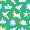 Origami seamless pattern with flat icons. Paper cranes, bird, boat, plane vector illustrations. Colored background green