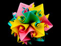 Origami sphere colored paper isolated on black background Stock Photos