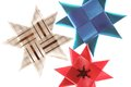 Origami stars from ribbons background Royalty Free Stock Images