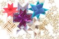 Origami stars  on the snowflake garland Stock Photos