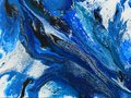 An acrylic pour painting with cells and water flowing. Royalty Free Stock Photo