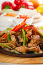 Original fajita sizzling hot  on iron plate Stock Image