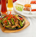 Original fajita sizzling hot  on iron plate Royalty Free Stock Images