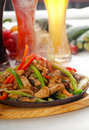 Original fajita sizzling hot  on iron plate Royalty Free Stock Photography