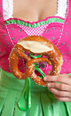 Original german pretzel with dirndl in the background Royalty Free Stock Photo