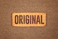 Original leather label tag on cotton fabric texture background Stock Photos