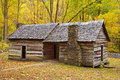 Original log cabin in smoky mtns during autumn with stone fireplaces along the roaring fork motor trail great mountains Royalty Free Stock Photo