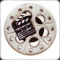 Original old movie reel for mm film projector with clapper boa big cinema loaded board on neutral background vintage color effect Stock Images