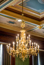 Original ornate glass chandelier in the supreeme court in des moines iowa court room with painted ceilings Royalty Free Stock Photos