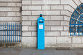An original police telephone free for use of public on the streets of london blue call post box by mansion house city Stock Photos