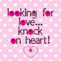 The original spelling of the phrase looking for love knock on heart a pink background with white hearts words Stock Image