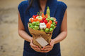 The original unusual edible vegetable and fruit bouquet  with card in woman hands Royalty Free Stock Photo