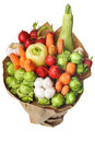 The original unusual edible vegetable and fruit bouquet on white of vegetables fruits background Stock Photos
