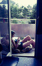 Original vintage colour slide from 1960s, young woman relaxing a Royalty Free Stock Photo