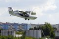 The orion sk amphibian in flight over the city Stock Image