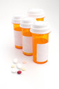 Ornage containers with different tablets Stock Photo