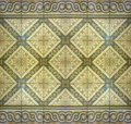 Ornament floor background real decorative mosaic with flower and motif in yellow and pale brown tones useful as or pattern Stock Photo