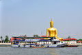 Ornament: huge gold buddha statue near river Royalty Free Stock Photo