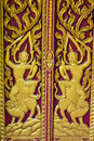 Ornament wooden door of thai temple in chiangmai thailand Royalty Free Stock Image