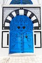 Ornamental blue door typical in sidi bou said tunisia Royalty Free Stock Photo