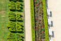Ornamental english garden with white benches aerial view Royalty Free Stock Photo