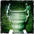 Ornamental flower pot with angels Stock Photo