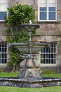 Ornamental fountain stourhead house stourton wiltshire england in front of a national trust property Royalty Free Stock Images