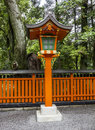 Ornamental orange wooden lantern at a japanese shinto shrine Royalty Free Stock Photo
