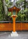 Ornamental orange wooden lantern at a japanese shinto shrine Royalty Free Stock Photo