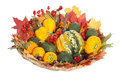 Ornamental pumpkins and autumnal decorations rose hip chestnuts colorful leaves in a basket isolated on white background Stock Photo