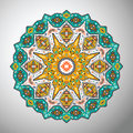 Ornamental round colorful geometric pattern in aztec style Royalty Free Stock Photo