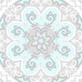 Ornamental seamless ethnicity pattern in cold colors the circular arrangement of stalks and leaves ornament of light pastel gray Royalty Free Stock Photos