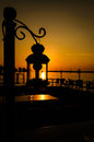 Ornamental Street Lamp On Sunset Royalty Free Stock Photo