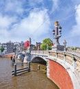 Ornate ancient bridge in Amsterdam, Netherlands Royalty Free Stock Photo
