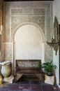 Ornate bench and archway in courtyard in cordoba spain carved moorish alcove jewish quarter of europe Stock Photo