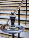 Ornate brass bannister antique railing to exterior stone steps Stock Images