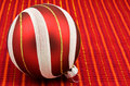Ornate christmas bauble on red Royalty Free Stock Photo