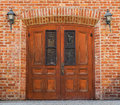 Ornate church door with brick building Royalty Free Stock Photo