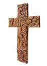 Ornate cross hand carved wooden on a white background at angled view Royalty Free Stock Photos
