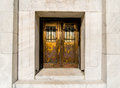 Ornate doors brass and copper with bars on the windows Royalty Free Stock Photos