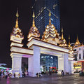 Ornate gate near shopping mall at night, Kunming, China Royalty Free Stock Photo