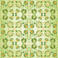 Ornate green and gold flower design Stock Images