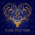 Ornate heart golden filigree on royal blue fancy background Stock Image