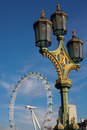 An ornate lamp post on westminster bridge london uk january with a view of london eye jan Royalty Free Stock Photo